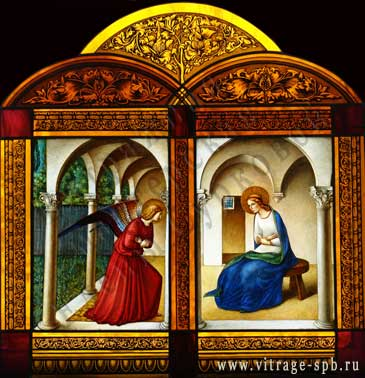 Annunciation. Stained-glass window. Painting in the glass. Painting on glass.